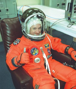 Scott J. Kelly is suited up and ready for the second launch attempt of Space Shuttle Discovery. He served as pilot on STS-103 in 1999 and has logged more than 191 hours in space.