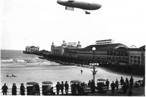 The vacation resort and emerging aeronautical activities drew people to Atlantic City. Over the Steel Pier is what appears to be an open gondola dirigible.