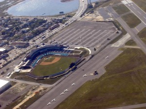 This photo, taken in 2000, shows only a handful of resident airplanes. Water surrounds the field on three sides. The highway behind the stadium, Albany Avenue, is the only land connection to the field.