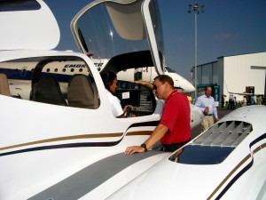 Jonathon Sweatman, regional sales manager, discusses the finer points on the Diamond DA42 with Debra Spengler, at the annual NBAA convention.