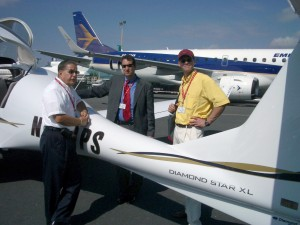 Art Spengler (left) discusses the finer qualities of the Diamond Star XL with two engineers from Boeing.