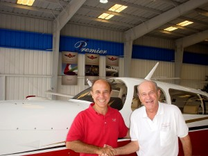 Fred Ahles (left) congratulates Bob Kwass on his new 2005 Mooney Ovation. The plane was Premier's 200th in just two years in business.