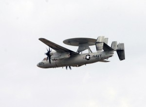 A naval E-2 Hawkeye makes a pass prior to departure.