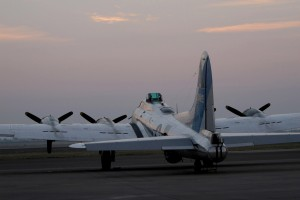 The Commemorative Air Force's B-17 Sentimental Journey sits on the bomber ramp as the sun sets.