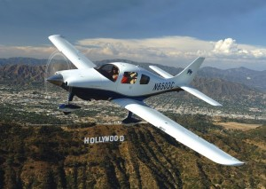 An iFly Columbia 350 flies over Hollywood, with the San Fernando Valley in the background.
