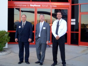L to R: Gary Brown, avionics manager, Tony Marlow, general manager, and Mike Fleming, service manager, welcomed VIP guests to Raytheon Van Nuys' open house.