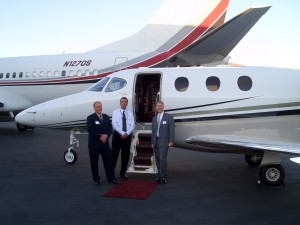 L to R: Gary Brown, Mike Fleming and Tony Marlow invite guests to view the inside of Raytheon's Beechcraft Premier.