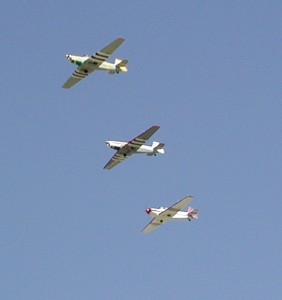 "The bride, Susan Newman (in the number three position), took part in a formation flyby in her Zlin 526L, as ""From This Moment On,"" by Shania Twain, played for the more than 600 attendees at the wedding."