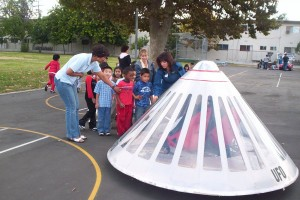 "Pilot Anne Marie Radel let students sit inside a model of a ""captured flying saucer."""