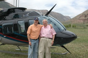 Jeff Puckett shows off his Bell 206 LongRanger, Prayer One, to Robert Puckett, his father and business partner.