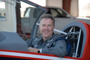 Jeff Puckett, in his Extra 300L, flies above Denver in Prayer One every Monday during his helicopter ministry.