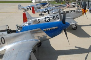 Four P-51 Mustangs sit on the ramp during the kickoff reception for the 2007 Gathering of Mustangs and Legends. The event expects to host more than 100 of these classic WWII aircraft, along with more than 50 living legends who made the Mustang famous.