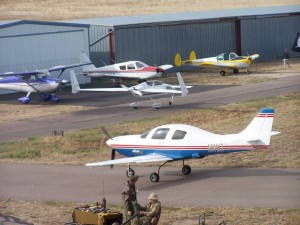 A Lancair and Long-EZ experimental homebuilt aircraft taxi by the factory built Cessna, Piper and Ercoupe aircraft at the Platte Valley Airpark Fly-In on October 14.
