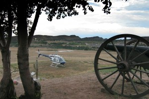 "The Fort's ""artillery"" stands watch over Rotor's JetRanger. The Fort and the surrounding area offer spectacular views."