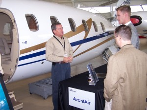 Paul Woodard, AvantAir director of sales southeast, shows the new Piaggio Avanti II to prospective customers.