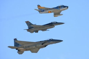Steve Hinton, in an F-86 Sabre (top) flies in tight formation with an F-16 Fighting Falcon and an F-15 Eagle.