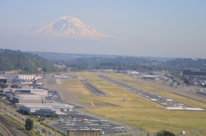 King County International Airport, shown with Mt. Rainier on the horizon, might be traded to the Port of Seattle, in exchange for a 47-mile railroad right-of-way that would become a regional hiking trail.
