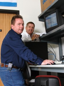 Randy Scott (left) and Marion Jenkins load updates to a client's computer.