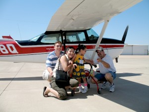 Isabel Hoesterey, her family and their pilot pose for a photo after a flight over north Texas. Fly Days not only lift the children to new heights, but lift their parents' spirits as well.