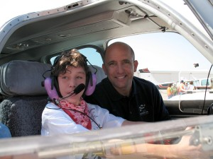 Greg Larson, volunteer pilot and Challenge Air advisory board member, is with a special copilot who's preparing for the flight of a lifetime.