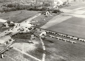 In the 1920s and '30s, pilots navigating towards Chicago frequently followed Milwaukee Avenue or Palatine Road, and landed at that intersection. Palwaukee Municipal Airport's name was derived from that intersection, shown in a 1929 photo.