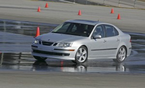 The skid pad teaches Saab owners how to handle their vehicle in snow, ice or wet road conditions. This vehicle is in the process of recovering from a skid on a wet road.