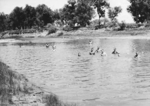 POWs, who finished their daily work quota, take a swim in the Belle Fourche River along Jack Rathbun's farm near Nisland. David Rathbun swam with them a couple of times, as did the American guard.