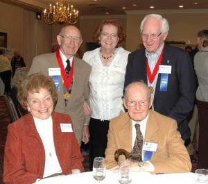 Lou and Charleen Clinton (seated), reminisced with Nick and Laura Nichols and Bill Duff (standing, far right).