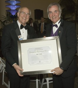 Bill Lennartz, San Diego Air and Space Museum president and CEO (left), presents Burt Rutan with a 21st Century of Flight Distinguished Achievement Award certificate. Rutan served as the event's keynote speaker.