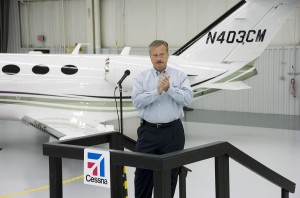 In an intense moment, Jack Pelton, Cessna's chief, applauds the FAA as it awards a production certificate for the company's first Citation Mustang at its assembly line in Independence, Kan.
