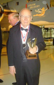Edward Swearingen proudly shows his Hall of Fame award.