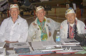 "L to R: E.E. Vaughn, G. Hemingway and Lewis La Geese, members of the Pearl Harbor Survivors Association, sign autographs and share memories at the ""Legends"" table."