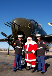 L to R: Marine Cpl. Jose Jarvis, Santa Claus and Cpl. Jeremy Everett teamed up with the B-25 crew and Anzio Landing, during this year's successful Toys for Tots campaign.