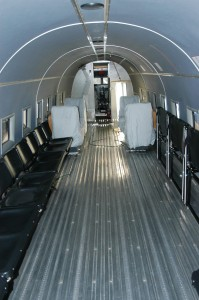 The side-facing seats fold up, as seen on the right. Removing the forward-facing seats allows seating for 40 troops.
