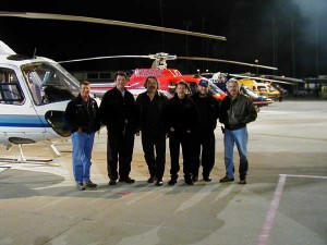 "Craig Hosking, second from left, pauses with his flying crew on the set of ""Cradle to the Grave."""