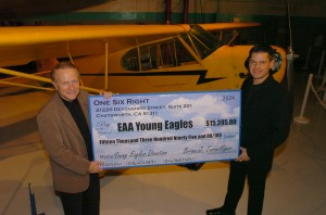 Brian J. Terwilliger (right) presented Tom Poberezny, president of the Experimental Aircraft Association, with a $15,395 check for the Young Eagles program.