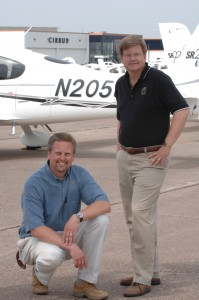 Dale (left) and Alan Klapmeier, in front of Cirrus aircraft parked outside the company's plant in Duluth, Minn., co-founded Cirrus Design Corporation.