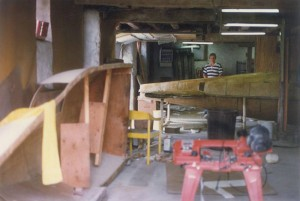 Alan Klapmeier works on the brothers' kit airplane, a VK-30, in their father's garage. The two built the airplane more than 25 years ago, while living in their family farmhouse in Wisconsin.
