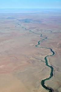 Parched and treeless below us, high plains rolled like soft flesh to the horizon, slashed by deep incisions, cut by water zigzagging through the land.
