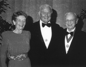 Elrey Jeppesen and wife Nadine were all smiles when he was inducted into the National Aviation Hall of Fame in 1990. Former astronaut and U.S. Senator John Glenn (center) was Jeppesen's sponsor.