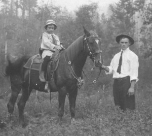 Young Elrey Borge Jeppesen sits atop a horse held by his father Jens, at the family farm in Odell, Ore., circa 1910. Jeppesen's love of nature, especially birds, sparked his interest in flight.