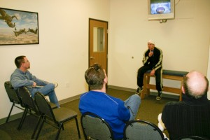 L to R: Tom, Michael and Jim Scott receive personal and video instruction before their bodyflight experience.