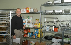 Dennis Heap, Front Range Airport's executive director, shows the storage room previously used for snack bar seating.