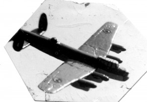 This scrapbook photo shows my solid model English Lancaster bomber. A dog ripped the model into 14 pieces, and the wings still showed the cracks after I rebuilt the plane.
