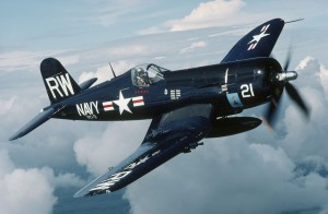The bent-wing bird, the F4U Corsair, soars through cloudy Texas skies.