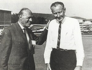 German aircraft designer Willy Messerschmitt pats Bob Hoover on the back.