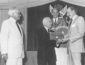 Former U.S. Senator Barry Goldwater (left) and Gen. James Doolittle present Bob Hoover with an Air Force Association award.