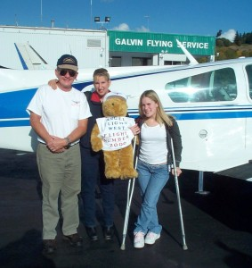 Tim Weston flew the Washington wing's 2000th mission, with assistant BJ Brandli (center) and Kari, who was flying to Children's Hospital for a checkup. Kari suffered brain trauma and a fractured pelvis when a truck hit her while she was riding a scooter.