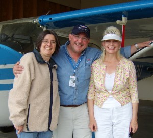 L to R: Children's Hospital social worker Jane Driscoll, with Washington pilots Christian Holtz and Ann Price, after returning from a special needs camp. Driscoll coordinated the Orkilla Camp for children on dialysis.