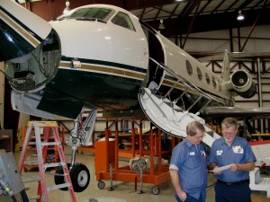 Wing Aviation employees Steve Ogden (left) and Bob Maager discuss the maintenance issues of this GIII.